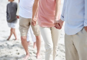Always together- Family holding hands at the beach