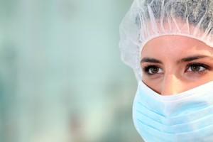 A surgeon wearing a mask