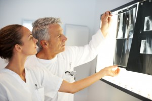 Serious medical colleagues examining an X-ray